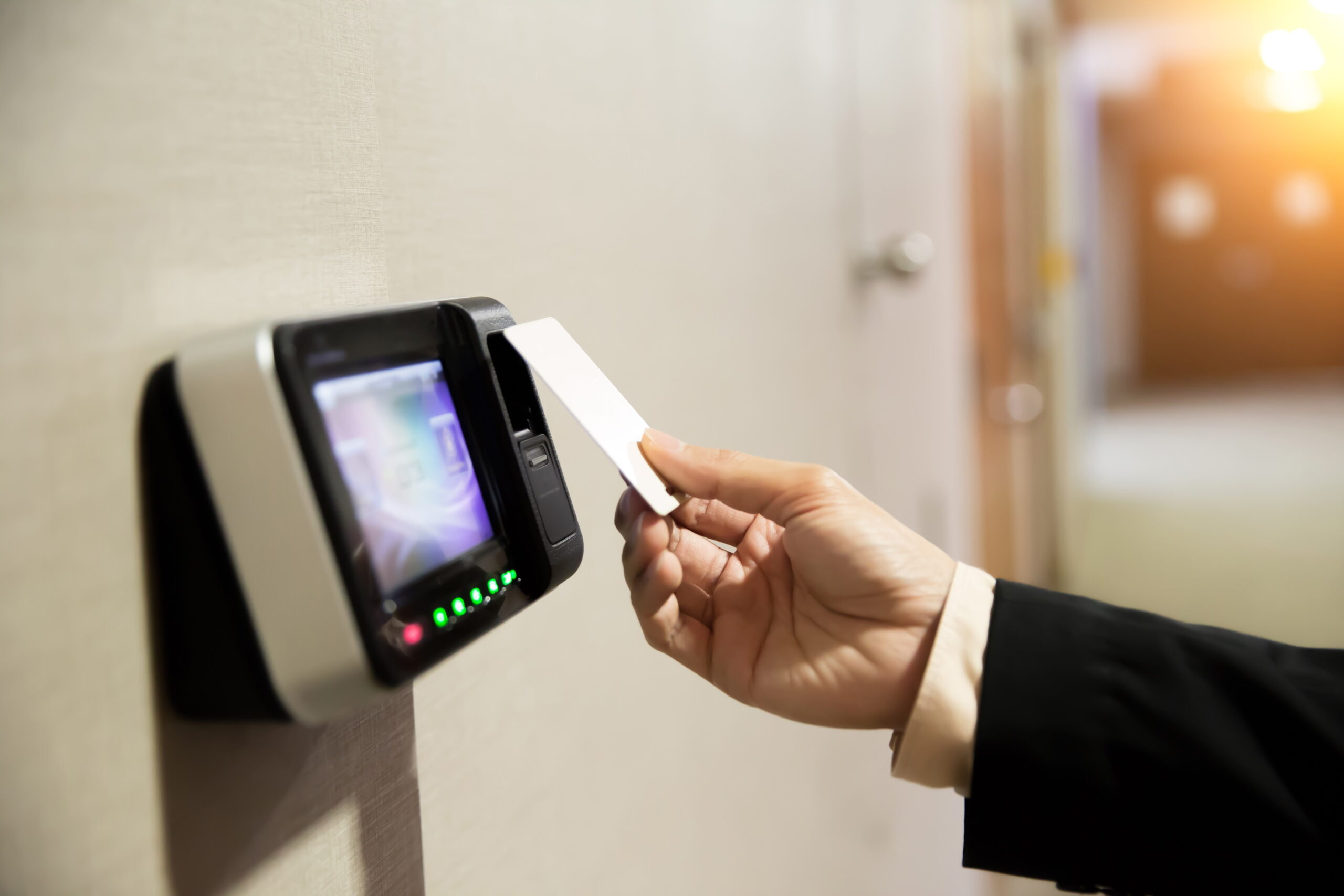 Close-up Of Hand Using Keycard To Open Door.